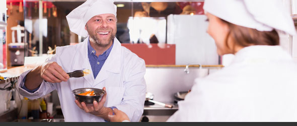Smiling corporate cafeteria vendor