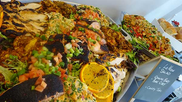 Photo of corporate catered food display of salmon and tofu.