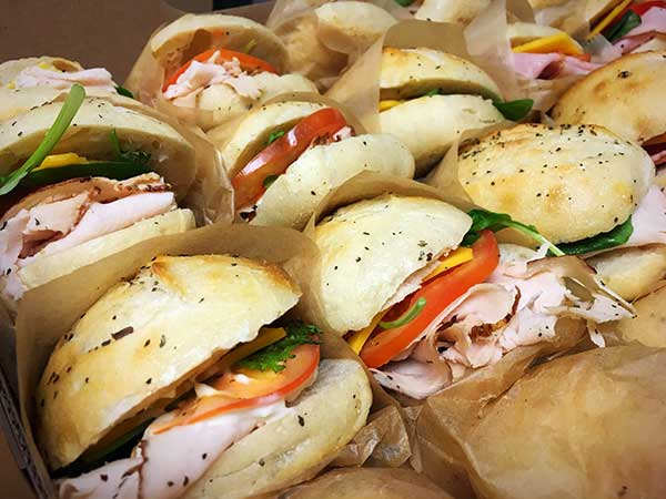 Photo of drop-off catering sandwiches for catered event.
