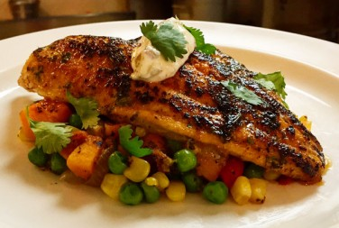 Chef Cory's cajun crusted catfish over a bed of butternut succotash