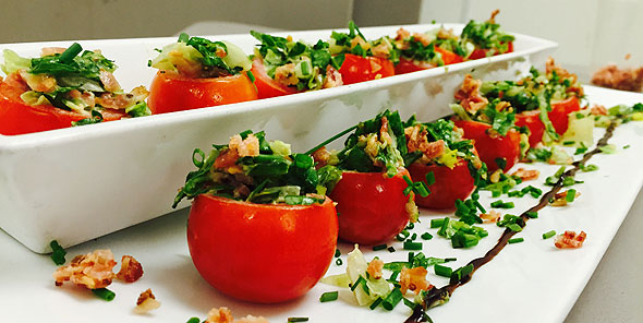 stuffed tomato display at corporate dining event