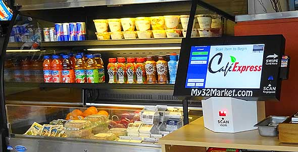 Photo of self-checkout kiosk in corporate cafeteria mini market.