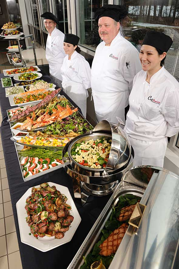 Photo of corporate dining food service employees at catered event