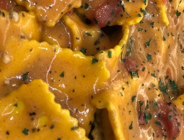 Butternut Squash Ravioli with Red Pepper Cream Sauce