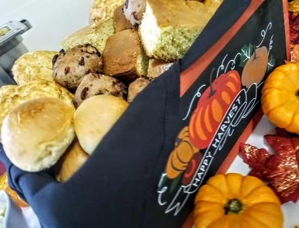 An assortment of fresh breads and muffins served at the Thanksgiving party in Brighton, Massachusetts
