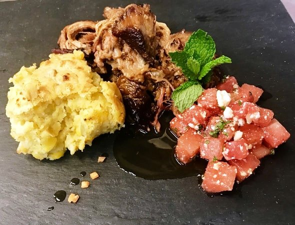 Pulled pork with Carolina vinegar BBQ sauce, Mexican spoon bread and watermelon mint salad at City Point in Waltham, Massachusetts