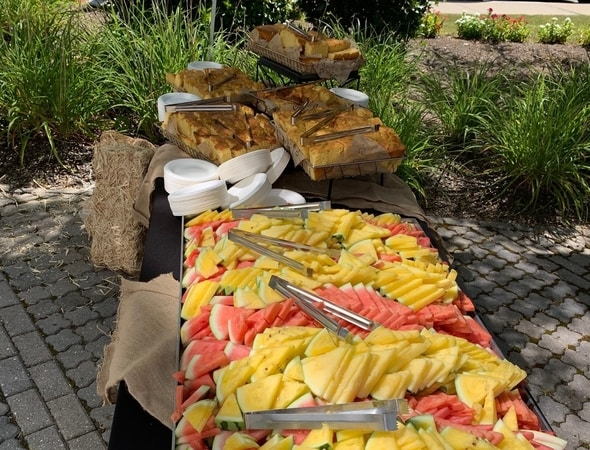 Fresh fruits and corn bread at the BBQ event