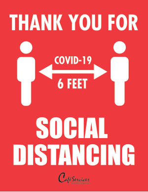 Social distancing safety sign for corporate cafeteria.